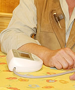 Man using a home monitoring device