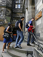 Students enter a building at New College