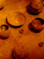 Ancient ceramic pots on a terracotta floor