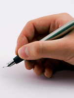A hand writing with a fountain pen