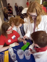 Student demonstrators and children enjoy the Science Festival events at the National Museum