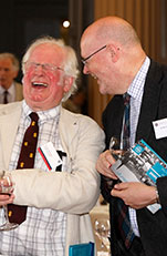 Two alumni laughing