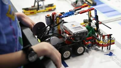 Child working on a Lego robot