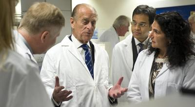HRH The Prince Philip Duke of Edinburgh and research staff from the The Euan MacDonald Centre.