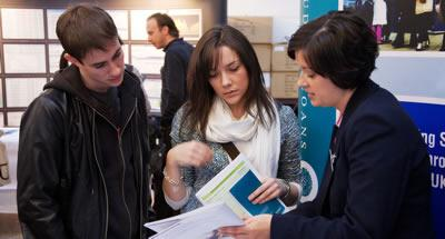 Students talking to an exhibitor at the Edinburgh Graduate Recruitment Fair.