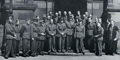Teaching staff and graduates after the graduation ceremony in the McEwan Hall, July 1942.