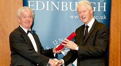 Professor Sir Timothy O'Shea and Bill Clinton