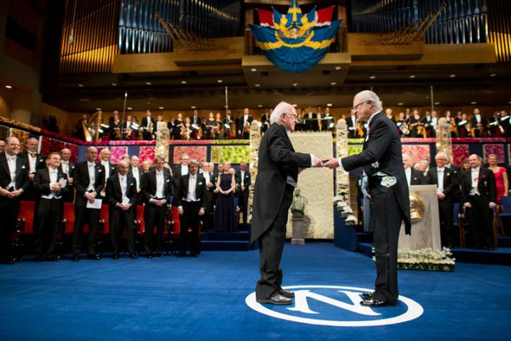 Professor Peter Higgs receives the Nobel Prize in Physics 2013 from King Carl Gustaf of Sweden during the Nobel Prize Award Ceremony in the Concert Hall of Stockholm, Sweden.