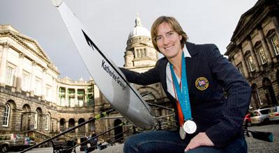 Katherine Grainger next to the University Boat Club's eight-person craft, which is named after her.
