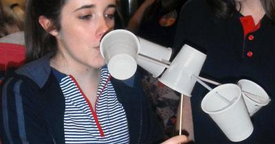 Photo of a Girl Guide using an anemometer to calculate wind speed for the Go For It! Weather challenge