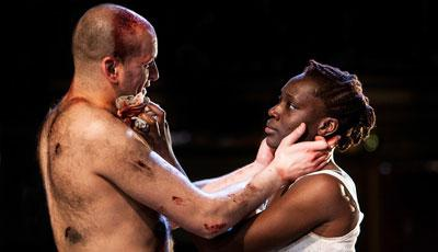 Photo of Ricky Champ as Josef the Fool (left) and Ony Uhiara as Lizaveta in Cannibals