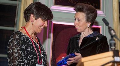 The Chancellor, HRH The Princess Royal, presents Dr Elizabeth Bomberg with her award