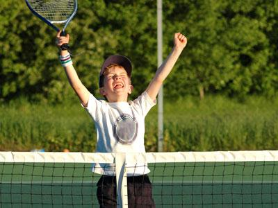 Photograph of boy playing tennis