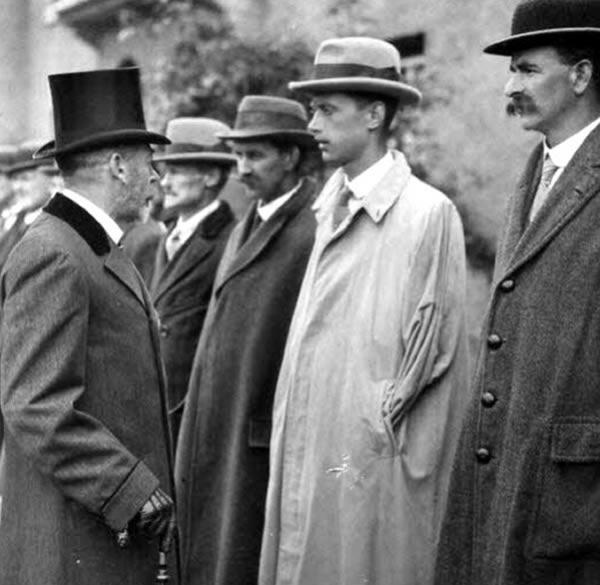 King George V meeting disabled veterans at the opening of Earl Haig Gardens where homes were built for ex-servicemen