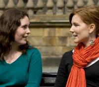 Two female students chatting outside