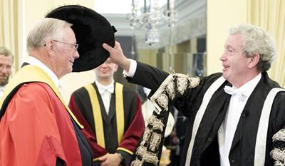 Neil Armstrong receiving his honorary degree from Tim O'Shea, University of Edinburgh Principal
