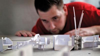 Architecture student working with scale models