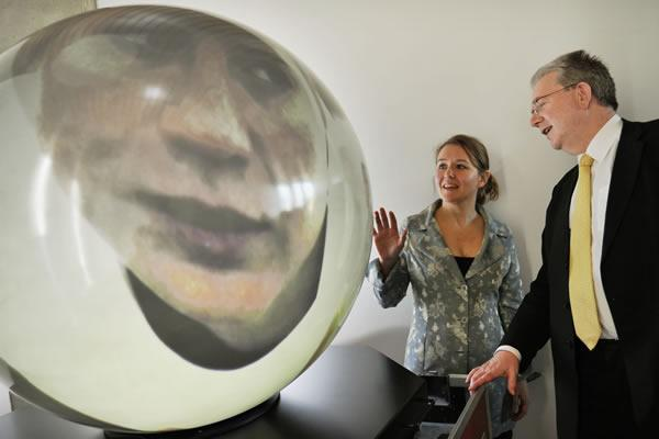 Mike Russell, Scottish Cabinet Secretary for Education, with the PufferSphere, a spherical display system developed by university firm Pufferfish
