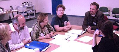 Photo showing several adults in a meeting