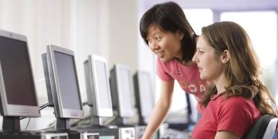 Two female students in the computer lab