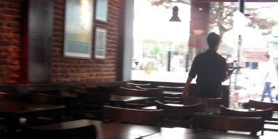 Waiter in cafe