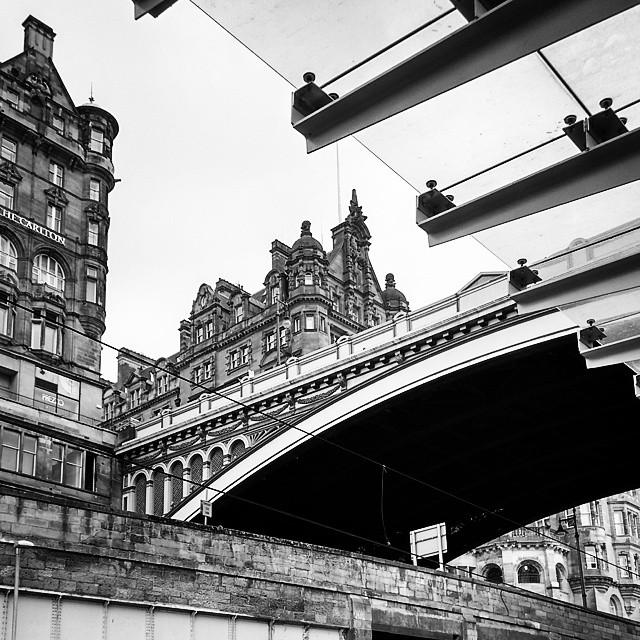 Black and white photo of North Bridge from below