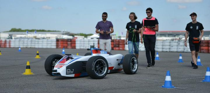 Photo of students with a driverless car