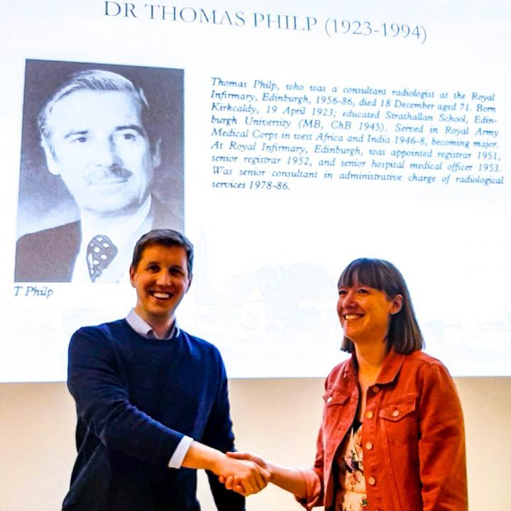 Dr Kenneeth Muir presents the 2019 Tom Philps prize to Dr Laura Middleton