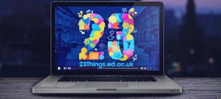 A laptop with the screen displaying a colourful number 23