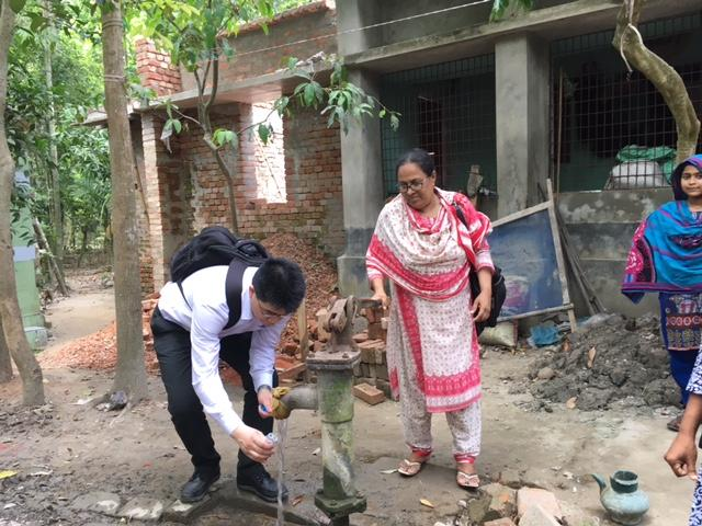 Dr Baojun Wang collecting water samples in Bangladesh