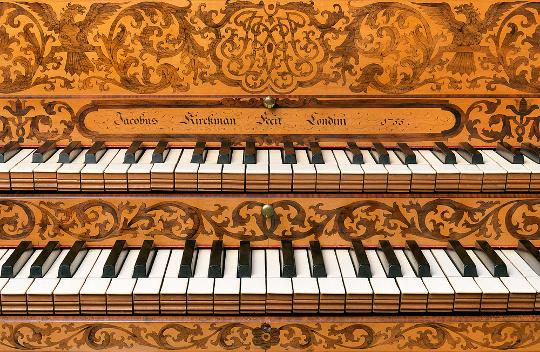 A close up of the keyboard of a Kirkman Harpsichord - showing two keyboards on top of each other.