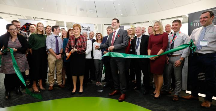 First Minister Nicola Sturgeon cutting the ribbon among a crowd to open the Roslin Innovation Centre.