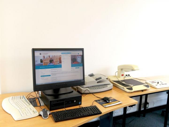 Accessible workstation, Law Library, with CCTV overhead magnifier, document feed scanner, ergonomic keyboard and Trackball mouse
