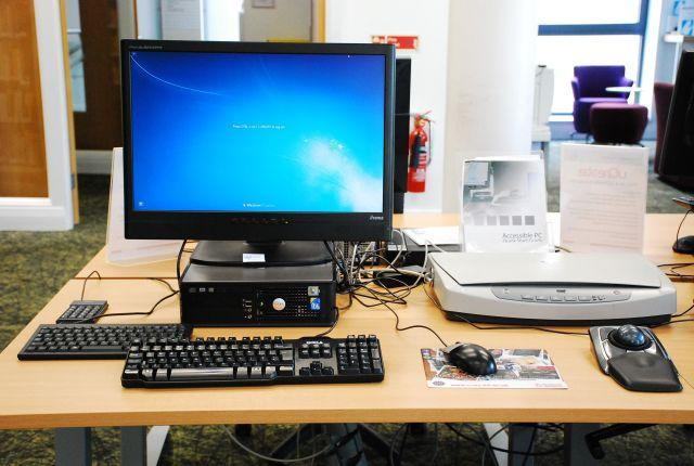 Accessible workstation, Noreen and Kenneth Murray Library, with flatbed scanner, compact keyboard, independent number pad and tr