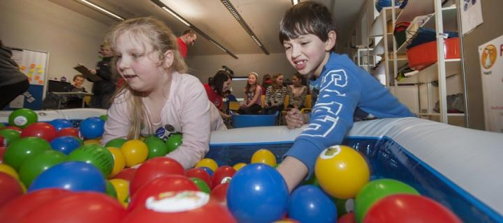 Participants in the Amazing Immunology workshop experience the 'rash decisions' ball pool