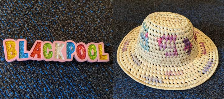 Colourful fridge magnet saying 'Blackpool' and hat with blue and purple streaks.