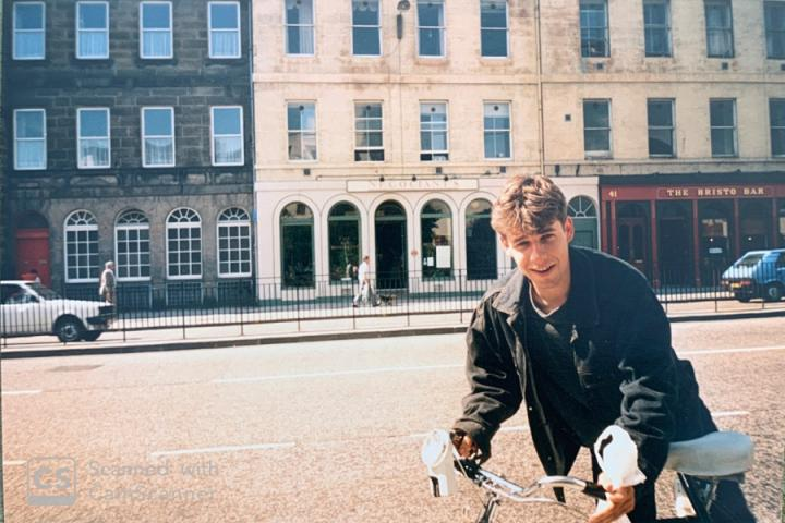 Anson Mackay riding a bike on Teviot Place in 1987