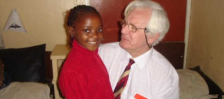Dr Peter McCormick with a child patient at a hospital in Cameroon