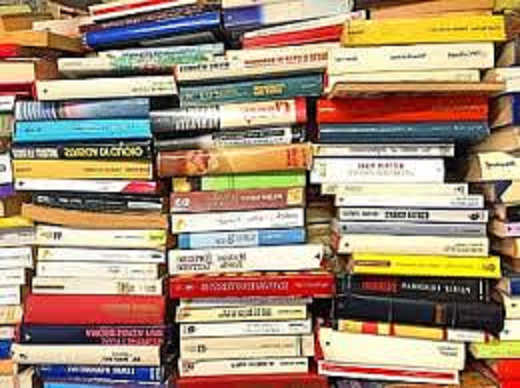 Photograph of books stacked on top of each other