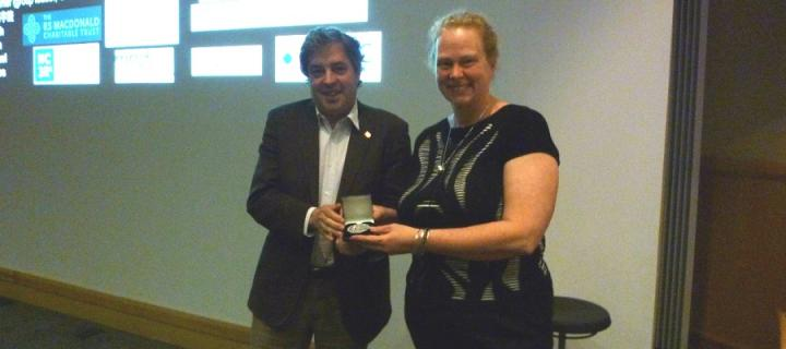 Professor Catherina Becker is presented with the 2016 Eurolife Distinguished Lecturer medal by Professor Jordi Alberch