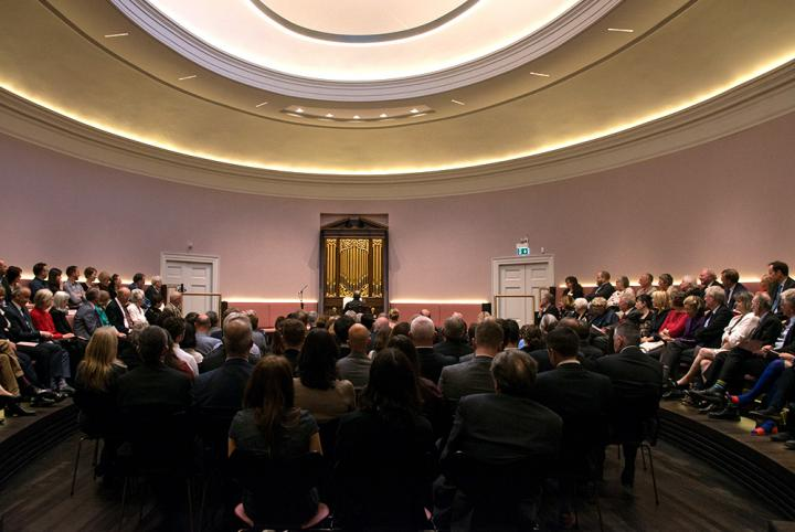 An audience enjoying a performance in the oval concert hall
