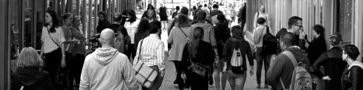 Crowd of people walking through a street