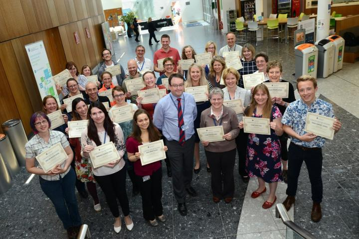 staff and students with their awards