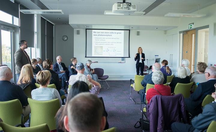 Researchers and clinicians engage with patients as part of the Eye Development & Degeneration event