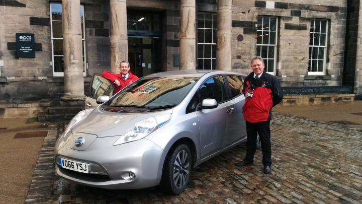 Security Officers Barry Edmonds and Gareth Satherley stand with the Nissan LEAF electric car