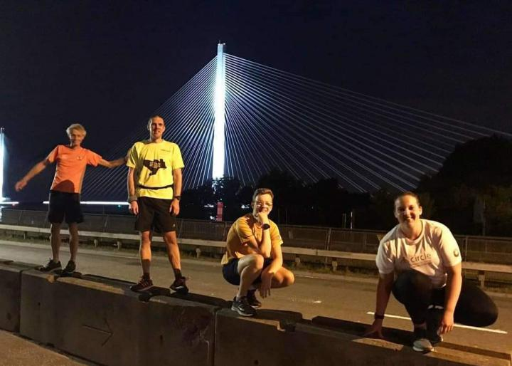 Edinburgh Imaging RIE radiographer, Isla (far right), during the DARED challenge in June - running 10k over the Forth Road Bridge at midnight.