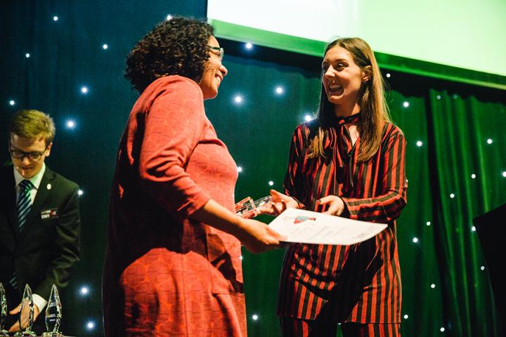 Photo of Eleoma receiving her award