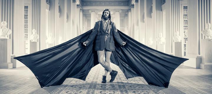 Photo of a man in a bat costume