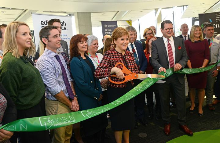 Nicola Sturgeon cutting the ribbon to inaugurate Roslin Innovation Centre with Chief Executive Officer John MacKenzie.