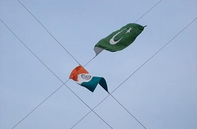 At the end of the guard changing ceremony at the Pakistan-India border the respective flags are lowered.